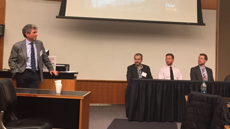 Geoff Ginsburg, director of MEDx, speaks with panel members Adam Wax, Matthew Kirley and Steven Brousell