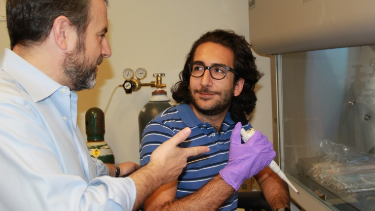 Master's fellowship recipient Jawad Hoballah, right, is using quantitative phase imaging to study laminopathy in a bronchial cell model in the lab of Professor Adam Wax, left.