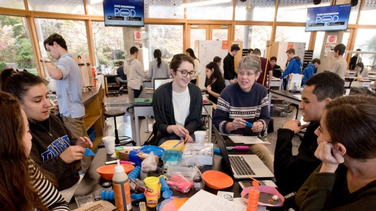 Duke Engineering students and Prof. Ann Saterbak working in the Duke Engineering Design Pod.