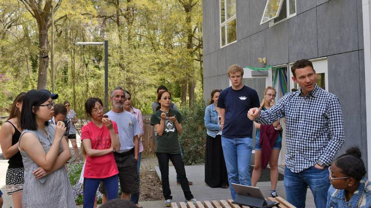 Duke graduate and former Duke Smart Home director Mark Younger, right, talks at the home's 10th anniversary celebration in April
