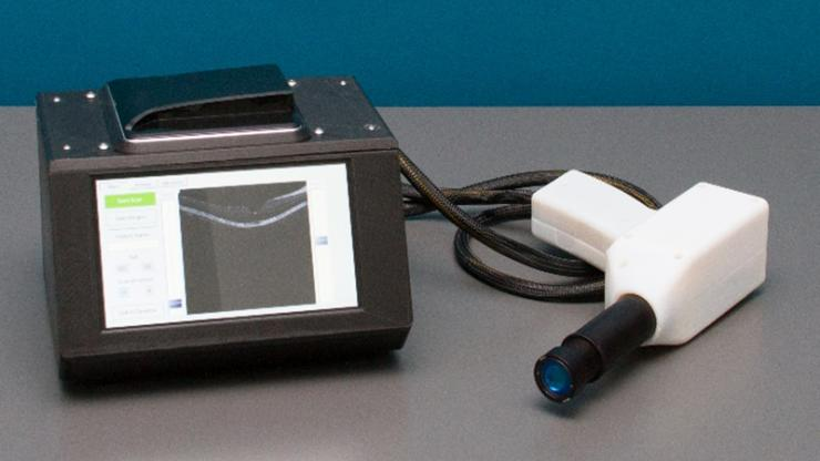 Small box with a screen and a boxy gun for scanning retinas
