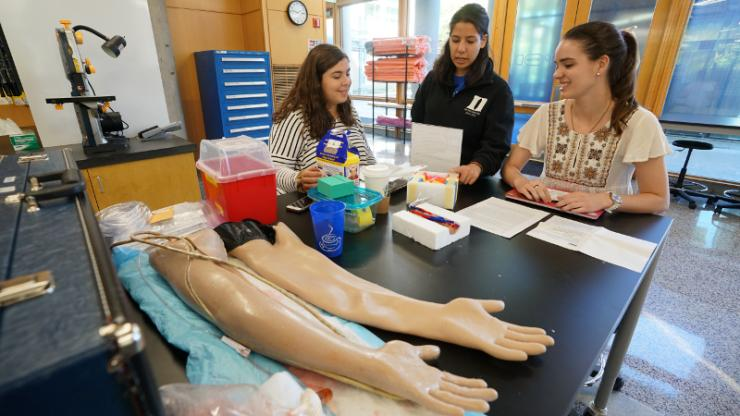 One of the first-year design teams works to develop a new model for training nurses how to insert a needle to draw blood.