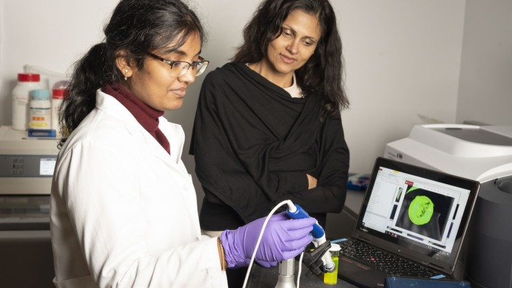 PhD student Enakshi Sunassee images a fluorescent specimen by using optical technology that was developed by the Center for Global Women's Health Technologies. All photos by Les Todd