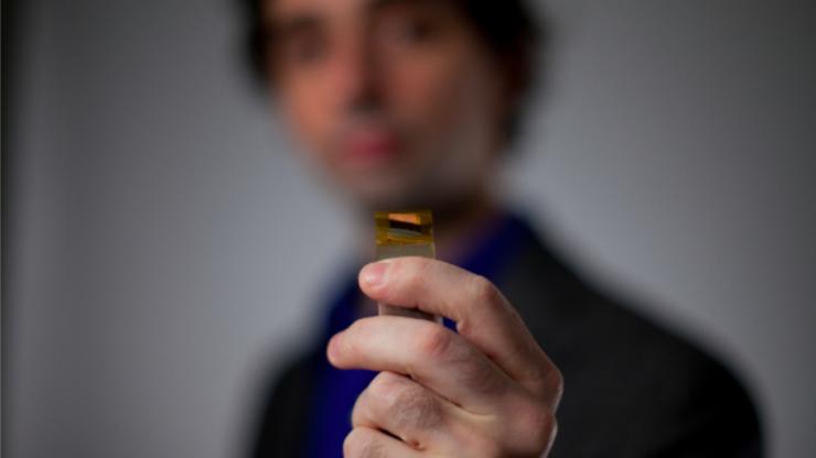 Jonathan Viventi holding one of his novel brain-interfacing electrodes.