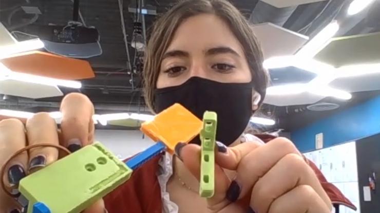 Alina Suarez with 3D printed test strip dispenser door