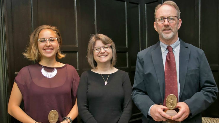 Sullivan Award winners Lauren Harper, left, and Rick Hoyle, right, received their awards from Provost Sally Kornbluth, center.