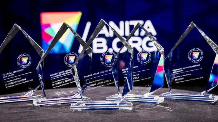 a row of five glass awards