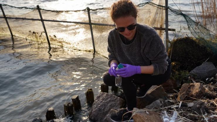 Student samples water in Kunshan