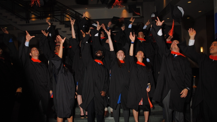 Pratt School of Engineering graduates celebrate after earning their degrees.