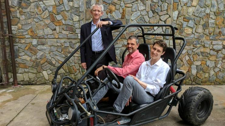 Mechanical engineering professor Josiah Knight, standing, with neuroscientists Angel Peterchev and Stefan Goetz on right. The team's new battery and power conversion system will be the heart of this student-built vehicle for the Shell Eco-Marathon.