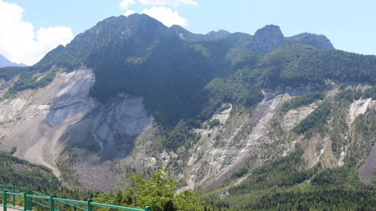 A mountainside with a lot of exposed rock
