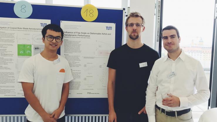 """Zheng """"Frank"""" Fang joins his supervisors Stephan Platzer, MSc, and Jürgen Rauleder, PhD, of the Technical University of Munich in front of his research poster, Influence of Flap Angle on Deformable Airfoil and Aerodynamic Performance."""