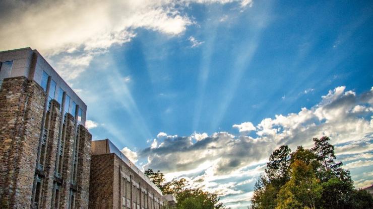 Sun breaks through clouds above Fitzpatrick Center