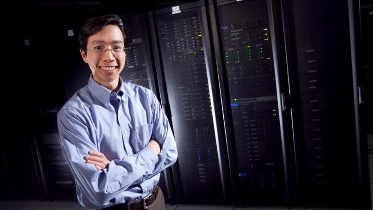 Benjamin Lee standing in front of computer servers