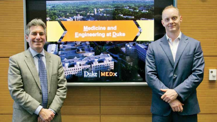 Geoffrey Ginsburg, director of MEDx, stands to the left of MEDx co-director Ken Gall, chair of the Department of Mechanical Engineering and Materials Science