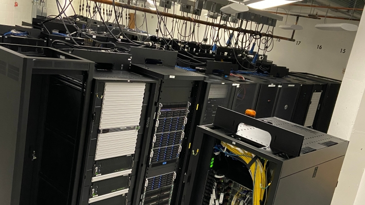 A bunch of computer servers clustered together in an IT room