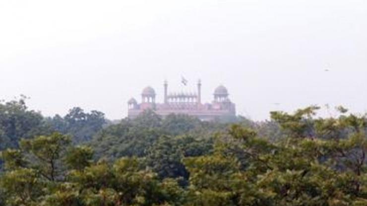 Smog hangs over the Red Fort in New Delhi, India. Some monuments in the country, like the Taj Mahal, are cleaned to remove stains created by air pollution. (Amanda Solliday / Duke University)