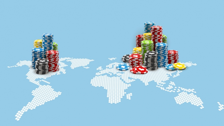 world map stacked with poker chips