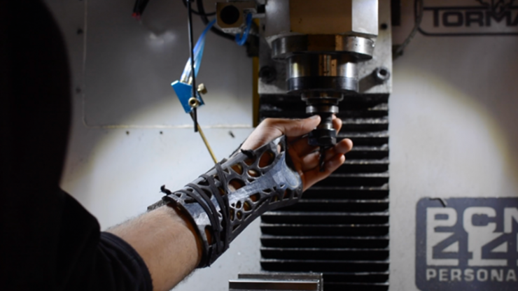 A wrist with a lightweight, 3D-printed wrist reaching for a machine