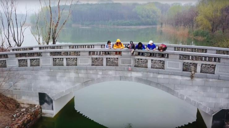 still from Kunshan video of students on bridge
