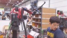 Yilun Zhou works with the team's picking robot at the Amazon Picking Challenge in Leipzig, Germany.