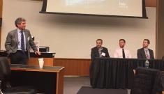 Geoff Ginsburg, director of MEDx, speaks with panel members Adam Wax, Matthew Kirley and Steven Brousell
