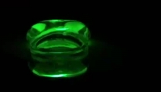 A neon green, semi-transparent, pill-shaped blob