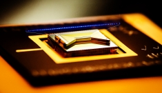A gold and black square device with a thin line of blue floating above its centerline