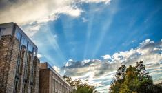 Sun breaks through clouds above Fitzpatrick Center