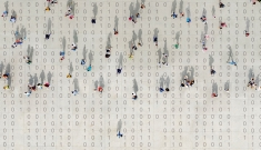 People walk atop binary code
