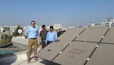 Duke engineering professor Michael Bergin (left) stands with Indian Institute of Technology-Gandhinagar colleague Chinmay Ghoroi (right) next to that university's dusty solar panel array