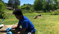 Duke Engineering PhD student sampling well water in Durham