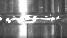 A freeze frame of molten rock oozing between two discs of rock being squeezed and rotated against one another