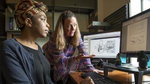 research scientist Boyla Mainsah with ECE professor Leslie Collins in lab