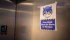 sign mandating mask in elevator