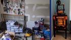 A garage with stacks of engineering supplies