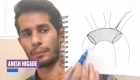 man pointing to drawing of aorta in a notebook
