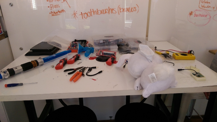 A table full of tools and toys for modification during an event co-hosted with mobile makerspace Betabox
