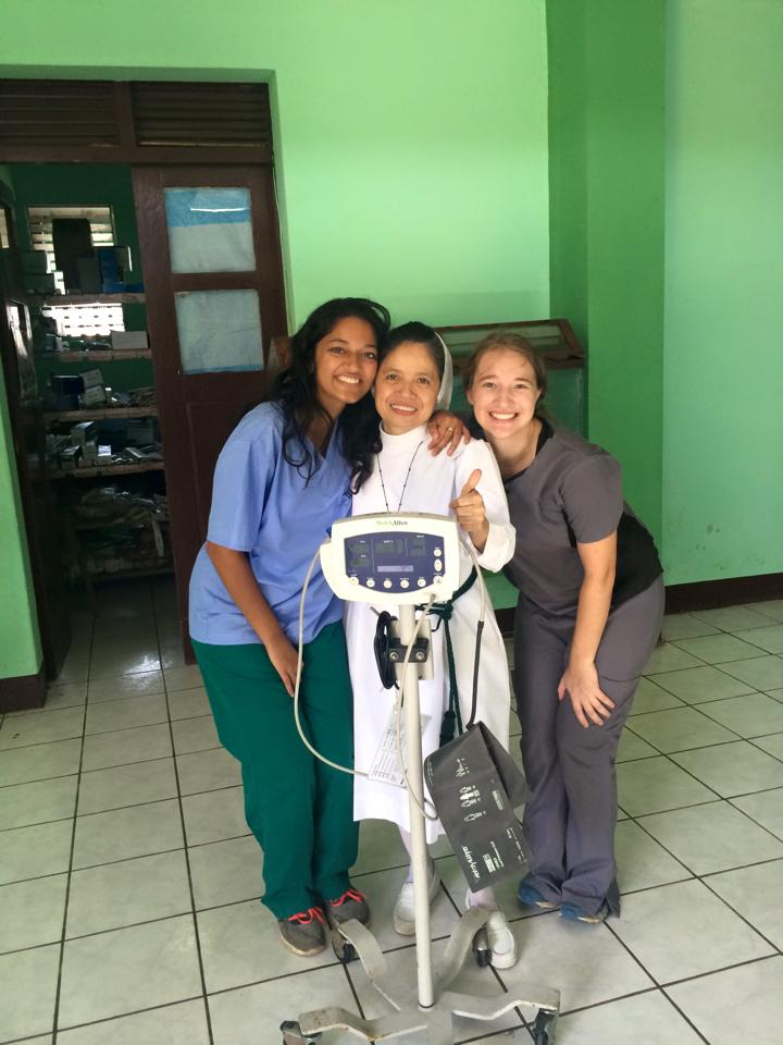 Raina Kishan (left) poses during one of her service trips to promote the Pocket Colposcope