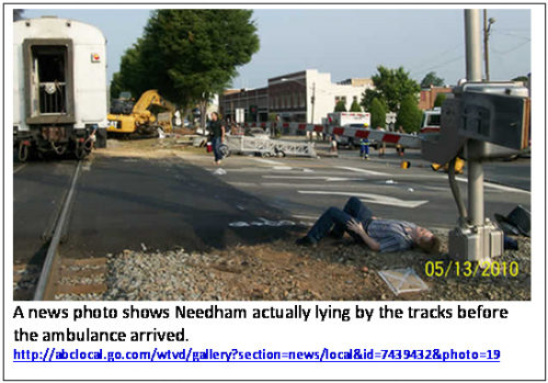 A news photo shows Needham actually lying by the tracks before the ambulance arrived.