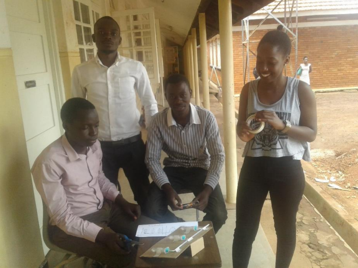 Ugandan students work on the oxygen regulator prototype in Makerere.
