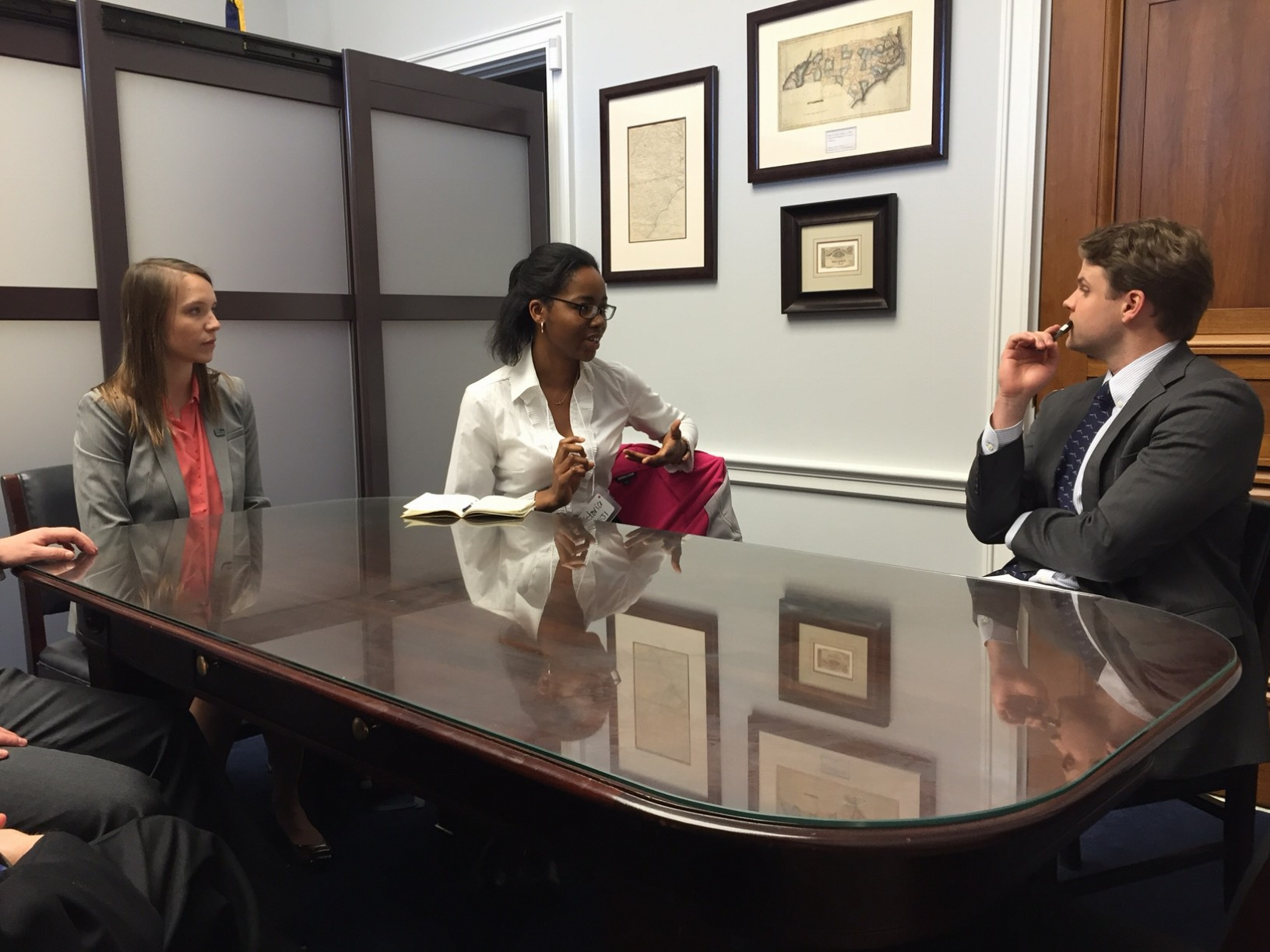 Victoria Nneji (center) makes the case for the importance of scientific research to James Hunter, senior legislative assistant for Rep. David Price (D-NC).